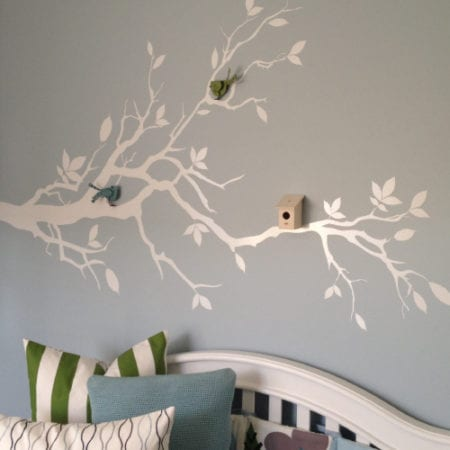White tree branches on bedroom wall